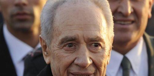 Peres zu Gesprächen in Berlin begrüßt