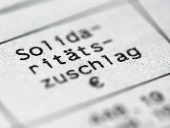 Union und SPD haben im Koalitionsvertrag verabredet, dass 90 Prozent der Soli-Zahler den Zuschlag ab 2021 nicht mehr zahlen müssen.