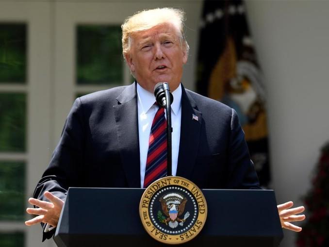 Donald Trump spricht im Rosengarten des WeißenHauses. /AP